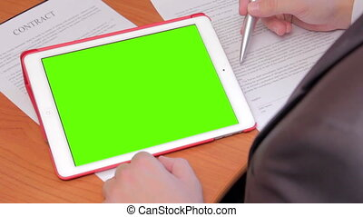Businessman using tablet P%u0421 - close-up of the tablet...