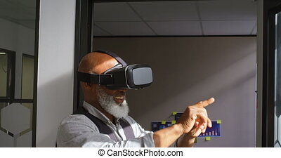 Businessman using virtual reality headset in the office 4k -...