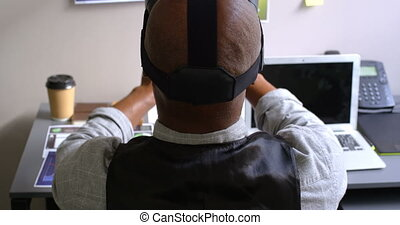 Businessman using virtual reality headset on desk in the office 4k