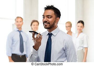 businessman using voice command on smartphone