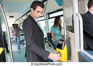 Businessman validating travel card