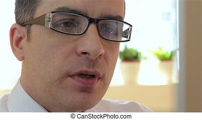Businessman via webcam - Businessman with glasses having a...