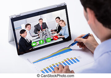 Businessman Video Conferencing On Hybrid Laptop