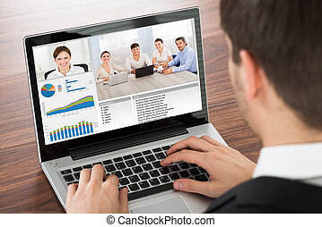 Businessman Video Conferencing On Laptop