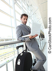 Businessman waiting at airport.