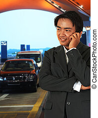 Businessman Waiting For A Taxi At The Airport