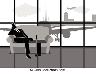 Businessman waiting his flight at the airport