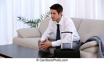 Businessman waiting with his suitcase