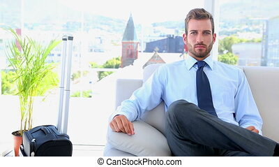 Businessman waiting to go on a trip