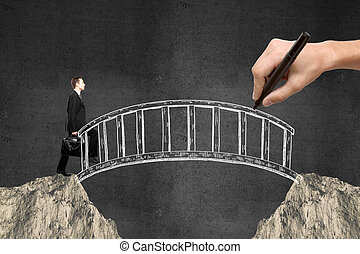Businessman walking across bridge
