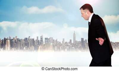 Businessman walking across tightrope with business text and cityscape in background