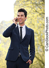 Businessman walking and talking on the phone