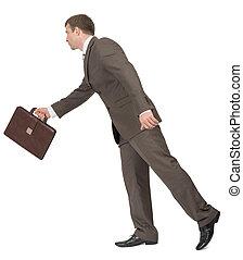Businessman walking forward, side view