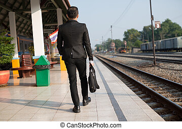Businessman walking in a rush hour to work. Hurry time.