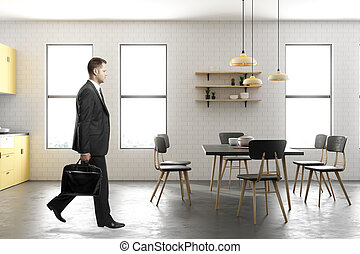 Businessman walking in contemporary kitchen