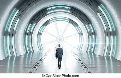 Businessman walking in futuristic concrete space ship interior