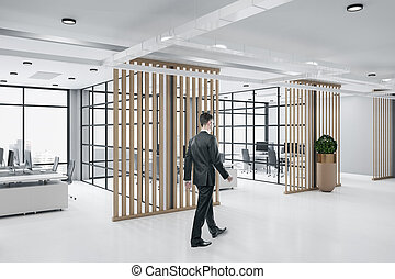 Businessman walking in loft style wooden ceo interior