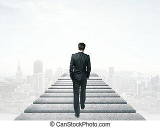 businessman walking in the sky