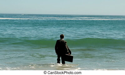 Businessman walking in the water