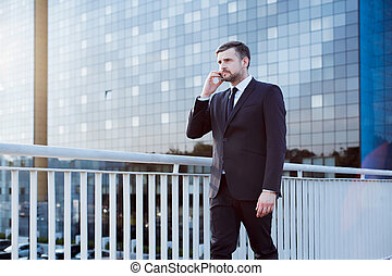 Businessman walking on bridge