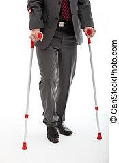 Businessman Walking On Crutches