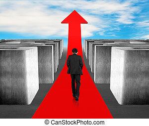 Businessman walking on growing red arrow through 3d Maze