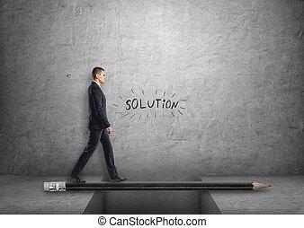 Businessman walking on pencil bridge across the gap
