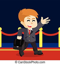 businessman walking on red carpet