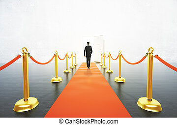 Businessman walking on red carpet concept