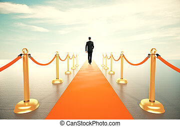 Businessman walking on red carpet to the sunny future concept