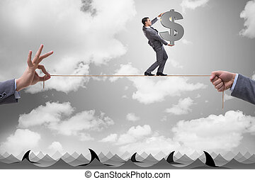 Businessman walking on tight rop in business concept