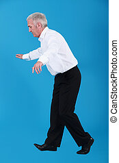 Businessman walking on tight-rope
