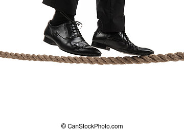 businessman walking on tightrope on white background....