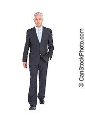 Businessman walking to camera