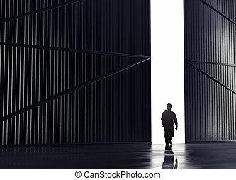 man walking - businessman walking to open gate