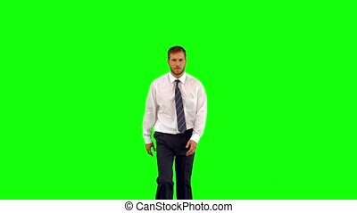 Businessman walking towards camera and shouting angrily on...
