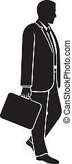 businessman walking with briefcase