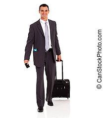 businessman walking with trolley bag
