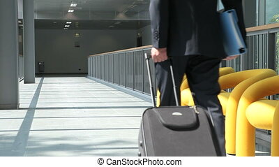 Businessman walking with trolley