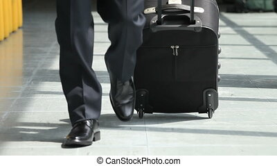 Businessman walking with trolley