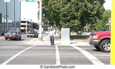 Businessman Walks Across Street