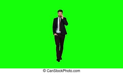 Businessman walks down the street, puts his hand in his pocket and waves. Green screen