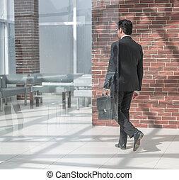 businessman walks in his office