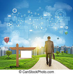 Businessman walks on road. Rear view. Buildings, grass field, wooden signboard and sky with virtual elements