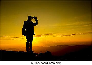 Businessman watch with binoculars - Businessman hold laptop ...