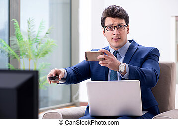 Businessman watching tv in the office