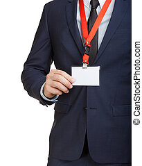 Businessman wearing a blank ID tag or name card on a lanyard...