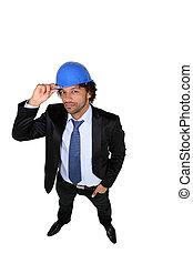 Businessman wearing a hardhat