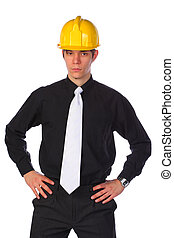 Businessman wearing a helmet, isolated on white - Elegant...