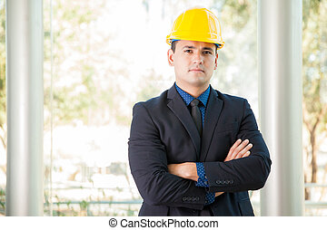Businessman wearing a helmet
